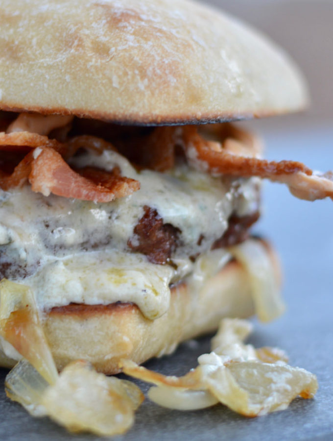 Mountain Burger with ciabatta bun, caramelized onion, bacon, and the most amazing cheese ever!