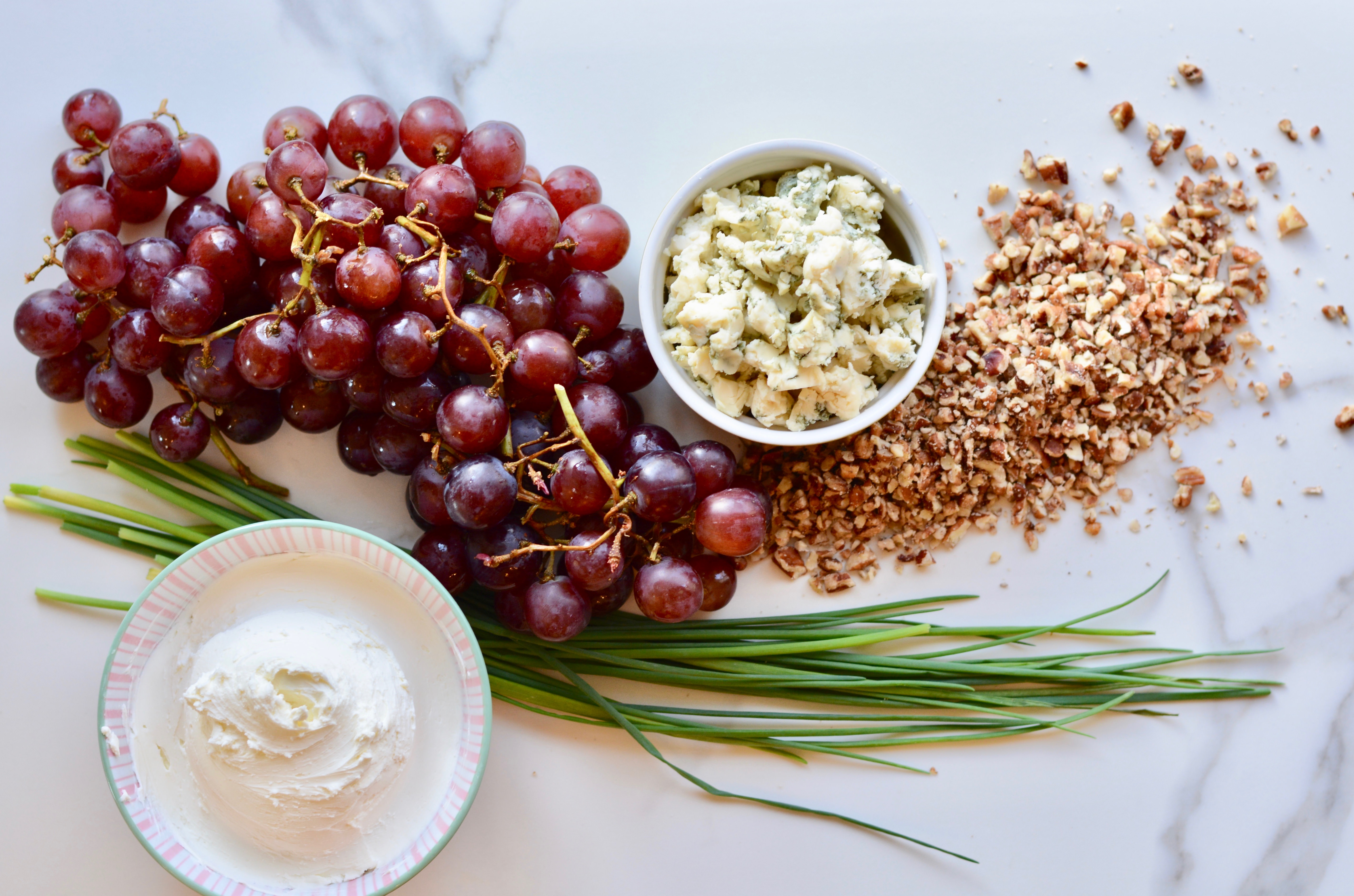 Refreshingly different appetizer! Cheese grape clusters made with cream cheese, gorgonzola and chives. Perfect, unique appetizer to make ahead.