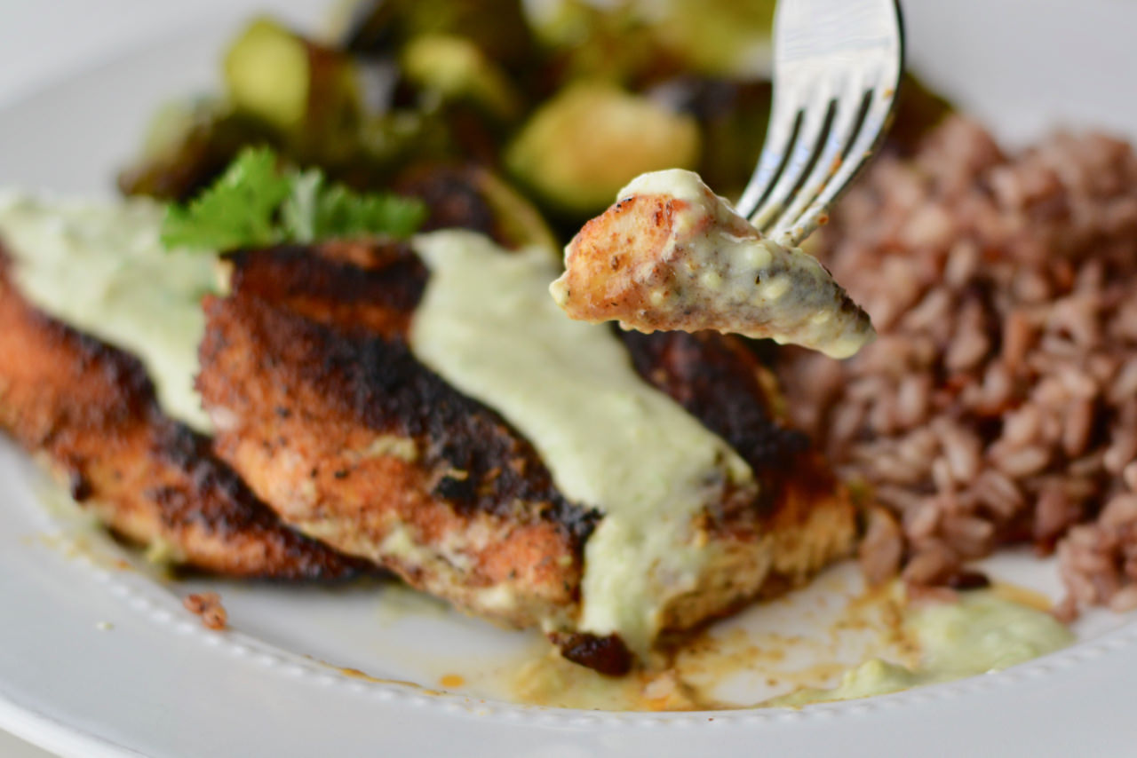 Spicy Blackened Chicken with Avocado Crema. Easy to prep ahead of time. Spice up your chicken tonight!