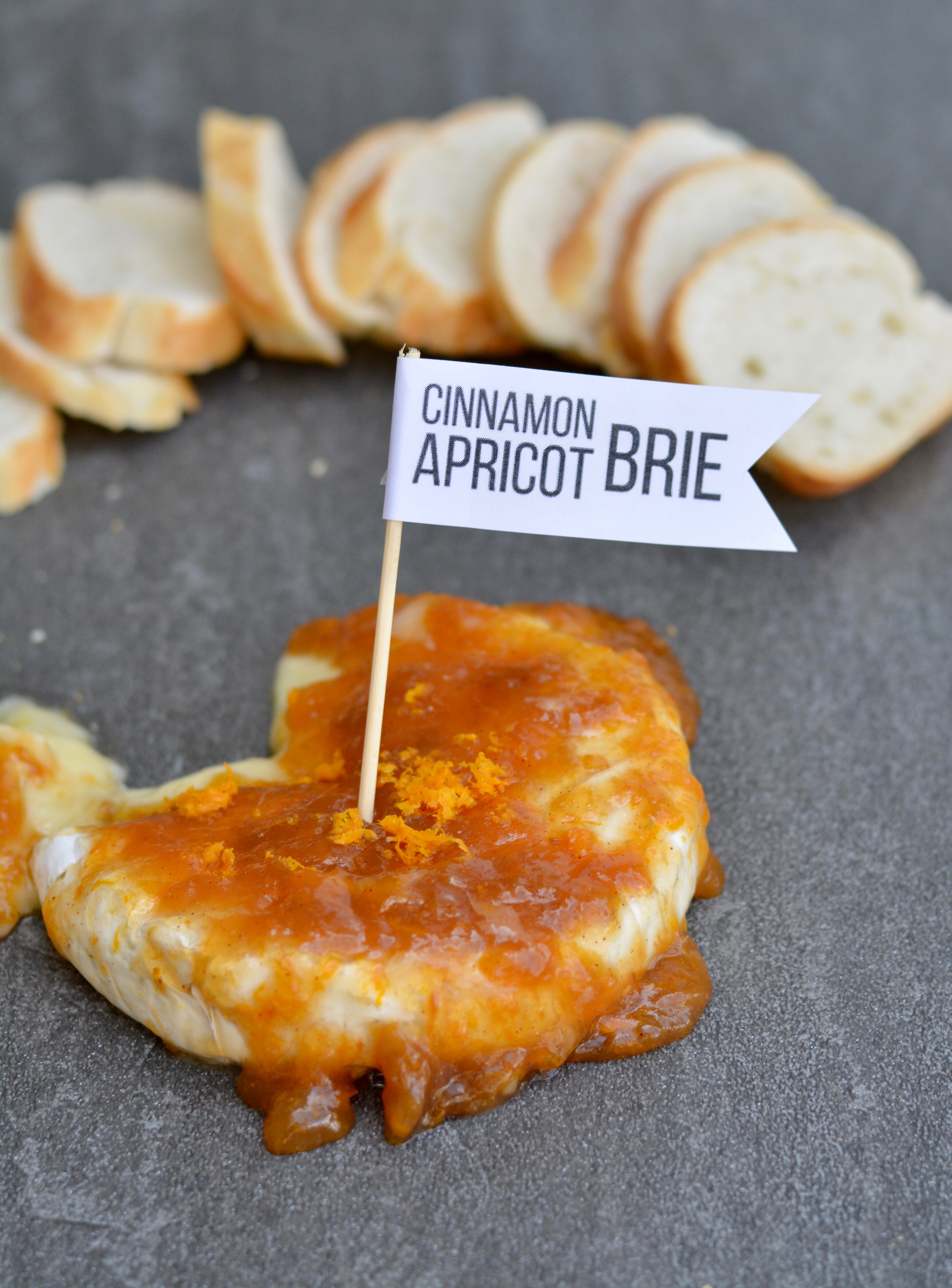 Apricot cinnamon brie cheese appetizer - crowd pleaser and super quick to prep! Creamy and sweet with a little tang, this is everyone's favorite appetizer!
