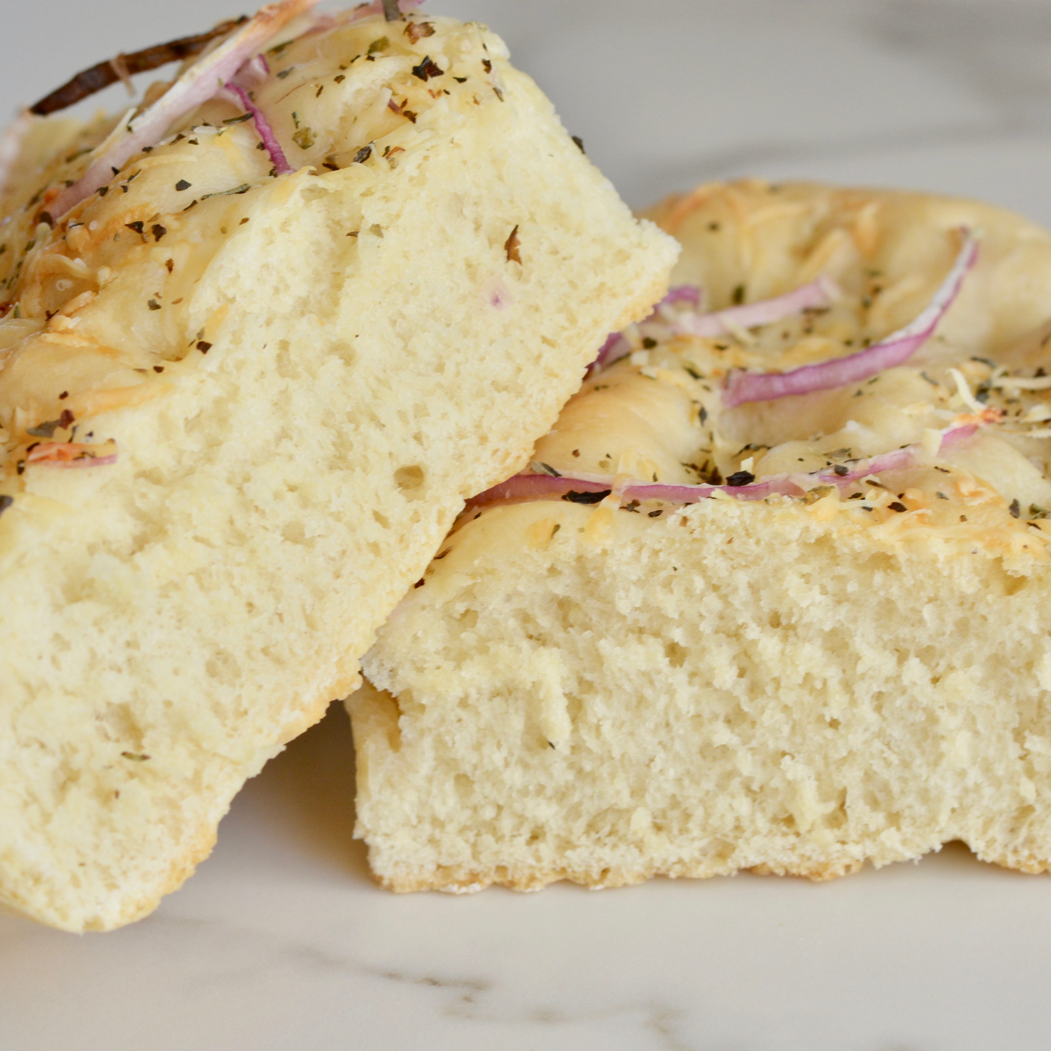 Easy focaccia bread, perfect for sandwiches or dipping in olive oil. This bread goes with every meal!
