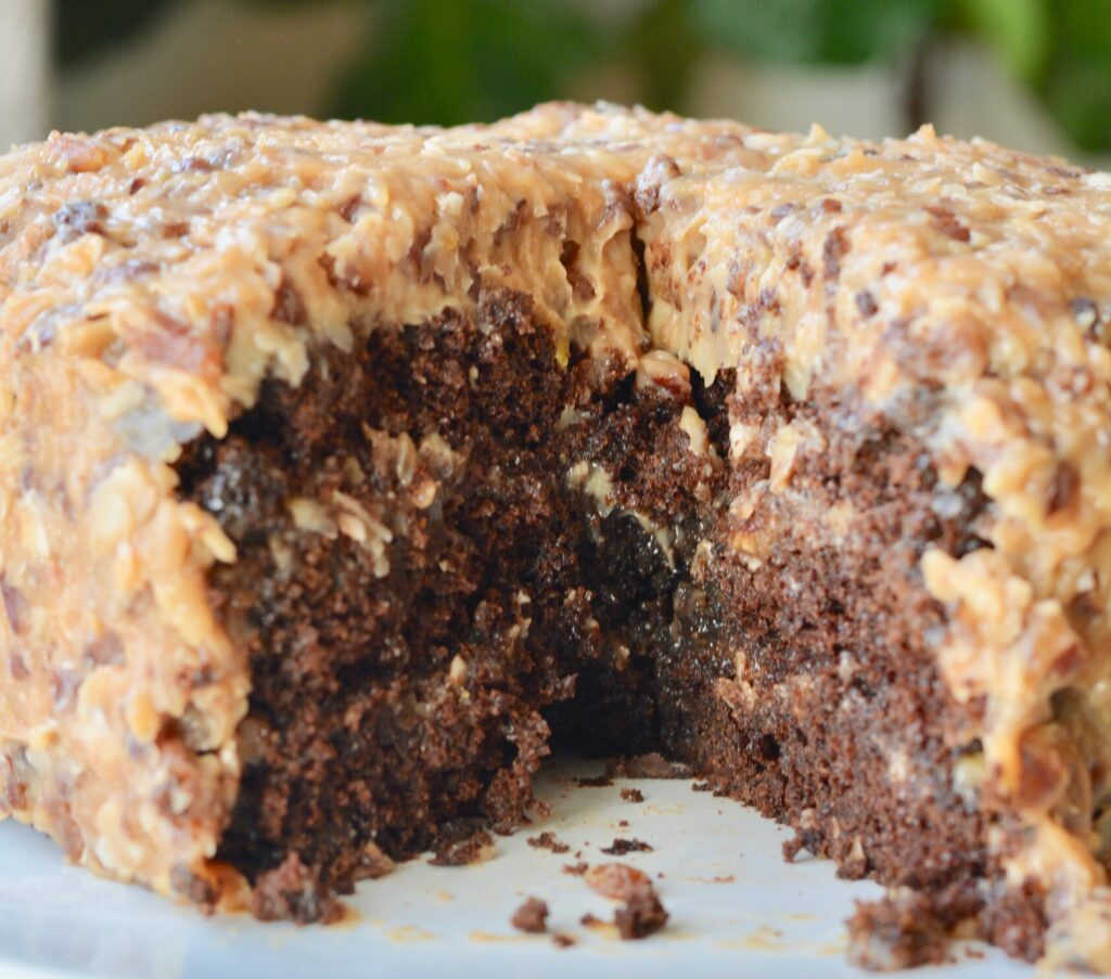 Perfectly dense German Chocolate Cake. Made with chocolate chips, plenty of coconut and pecans. Perfect for a birthday or any celebration!