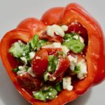 Healthy Italian Stuffed Peppers | Gluten Free Vegetarian appetizer or lunch. So fresh and delicious and easy to throw together. Cherry tomatoes, feta cheese, basil and olive oil stuffed into a red pepper and heated through. Absolutely delicious!