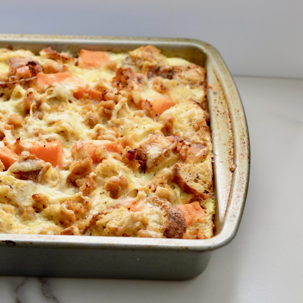 Breakfast Strata - easily made the night before - with sweet potato, chicken sausage, Monterey jack cheese and multigrain bread. Hearty and healthy make ahead breakfast.